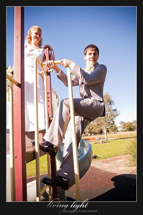 Groom climbing down from playground equipment.