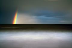 Elemental Metamorphosis (jasontheaker) Tags: ocean uk winter sea storm rain rainbow north stop filter nd ten 2009 thunder sandsend jasontheaker northyorkshire