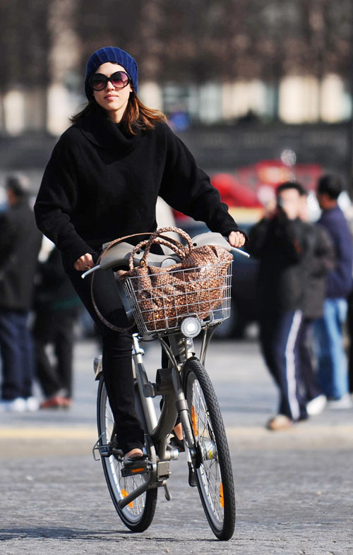Jessica Alba riding Velib in Paris