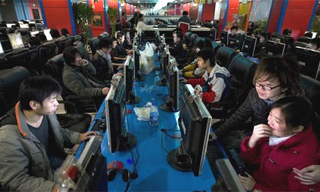 Surfers at an internet cafe in China Photograph: Dan Chung