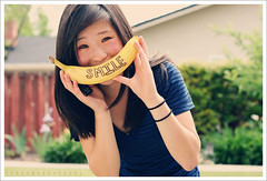 I Like to Eat Apples and Bananas.- Explored #3 (Sarah Ching) Tags: orange smile yellow fence outside bush stripes banana laugh bunch prints remote peel selling pints hairband vneck hairtie explored sellingprints tumblr sarahching trisarahhtops