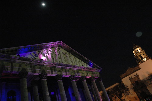 Library frieze, columns, colored light display, moon, downtown Guadalajara, Jalisco, Mexico by Wonderlane