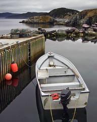 Wishin'  I Was Fishin' (Clyde Barrett) Tags: ocean sea newfoundland coast boat dock searchthebest calm pots wharf lobster nl traps nfld clydebarrett bareneed