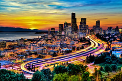Seattle in Motion at Sunset (Surrealize) Tags: seattle city longexposure blue trees sunset urban orange motion green cars yellow skyline clouds skyscraper buildings lights moving nikon downtown neon traffic i5 freeway pugetsound headlight curve washingtonstate emeraldcity hdr beaconhill taillight smithtower olympicmountains concretejungle columbiatower 9exp d700 surrealize