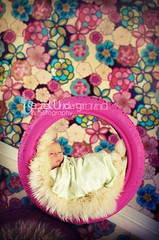 "9 days old and ""tired"" of life (Trifin) Tags: pink flowers baby girl nikon colorful bright gimp tire newborn prop paintedtire d700 nikond700 secretundergroundphotography"