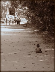 Alone on the road (Joketje) Tags: baby holiday nature sepia youth digital canon thailand asia cambodia alone child sad young reis single winner picnik shallowdepthoffield sepioso challengeyou challengeyouwinner thechallengegame challengegamewinner canonpowershotg9 beginnerdigitalphotographychallengewinner beginnerdigitalphotographychallenge