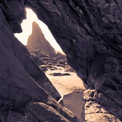 framed cove (LucasM.Pinelli) Tags: ocean city sun beach oregon sand rocks cove framed or lincoln framing tone westwind