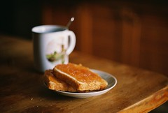 toast and marmalade (Liis Klammer) Tags: food film cup kitchen breakfast analog 35mm table tea bokeh toast plate spoon mug zenit crumbs marmalade zenitet applejam