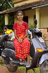 Portrait of A Goan Girl and Her Honda !! (Anoop Negi) Tags: world travel girls red portrait people india color colour men girl festival honda photography for photo amazing women essay media place image photos gorgeous delhi indian traditional bangalore goa creative picture culture traditions images best exotic human photograph hues journey po tradition mumbai journalism panjim  panaji goan ndia photosof  ezee123 bonderam  aveena diwar bestphotographer   imagesof anoopnegi  chaoro  jjournalism     n