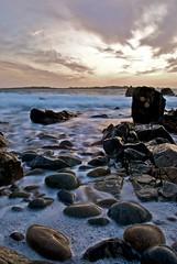Pembroke Bay (Samantha Warren Photography) Tags: longexposure sunset water clouds pembroke landscapes nikon rocks seascapes vale d200 guernsey manfrotto lancresse