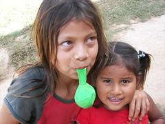 Michiplaya Young Girls (Kens Photoworks) Tags: girls southamerica kids village baloon blow preteen zut preteengirls michiplaya boliviarivertrip2009