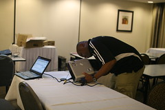 Michuki Mwangi setting up a projector