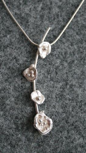 Silver flower branch pendant