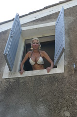 A Beautiful Woman Peers Out Window (California Will) Tags: france sexy beauty costume europe femme mature bikini blond da blonde belle michele provence elegant swimsuit bagno fr bathingsuit bellezza godess eoshe lgante