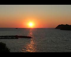 Sun&Sea (angelsgermain) Tags: light sunset sea summer sky sun beach island evening bay rocks colours petra greece lesvos aegeansea flickrestrellas