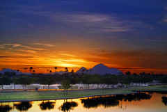 Watering (jimhankey) Tags: park morning winter red arizona sky orange cloud sun mountain mountains phoenix beautiful weather yellow clouds sunrise landscape gold morninglight spring desert cloudy scenic parks naturallight sunny valley copper vista orangesky glowing redsky dramaticsky 2009 beautifulclouds beautifulview sunray desertview daybreak phoenixarizona arizonawinter beautifulscenery phoenixaz scenicview desertmountain maricopacounty goldensky nikond200 phoenixskyline unusuallight glowingcloud indianschoolpark dearflickrfriend uptownphoenix goldenmorning jimhankey arizonaspring arizonaweather phoenixweather phoenixariz