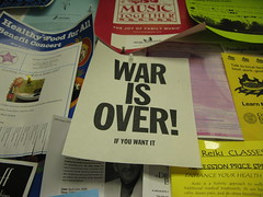 ari put up this war is over! poster in the dew...