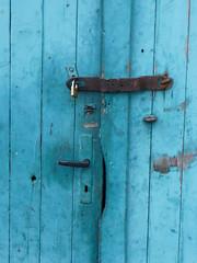 Rotten door, shiny lock