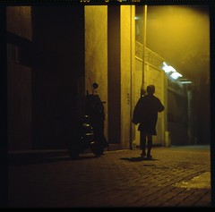...and i went out in that bad old world to roam (hurtingbombz) Tags: shadow 120 6x6 girl night dark hongkong alley solitude shadows tl streetlamp scooter mf provia f28 pentaconsix kwuntong 150mm 400x pushedtwostops kaleinar3b