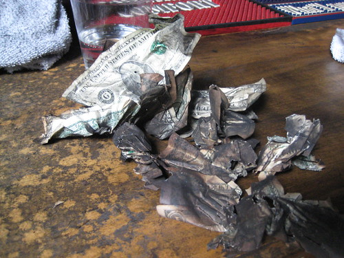 These are some of the dollars that came off the ceiling. People would throw dollars backed by thumbtacks to the ceiling. Thanks to divide on Flickr for the photos. Check out the rest of his set (photo link).