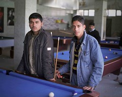 Lads playing pool in Northern Iraq. (Ben Hodson) Tags: travel two portrait playing men love boys pool children hope blood war peace sad lads ben pair iraq middleeast documentary east together stare middle northern iraqwar iraqi sacrifice kurdistan playingpool kurdish kurd kurds preemptive hodson northerniraq iraqikurdistan sulaymaniyah solum magmag benhodson preemptivelove wwwbenhodsoncouk