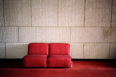 red sofa (xgray) Tags: red color texture film lines wall analog 35mm austin carpet nc bottle university texas kodak olympus xa2 universityoftexas sofa 400 minimalism olympusxa2 portra utc kodakportra400nc 400nc uploadx kodakprofessionalportra400nc postedtophotojournalsonlj xgrayvision2009