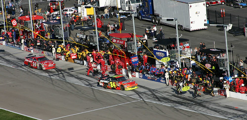 Tony Stewart and Jeff Gordon approach their pit stalls during a pit stop. We had a great view of their stalls since they were more towards the exit of pit road.