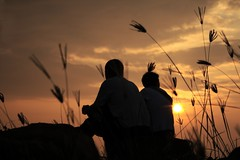Together (AgniMax) Tags: friends sunset love beach nature together romantic partners kovalam colorsofnature silhoutette peopleandnature natureandpeople