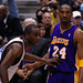 Kobe Bryant of the Los Angeles Lakers and Luc Richard Mbah a Moute of the Milwaukee Bucks