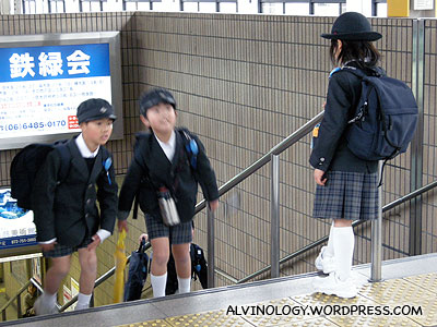 Kids in uniform at the train station