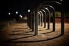 portal of lightlessness (0bli0) Tags: shadow canon dof bokeh handheld gravel bikerack followme wideopen taijitu dusk2dawn 50mmf12l blackwattlebaypark 5dmk2 ∩∩∩∩∩∩