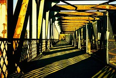 Repetition... (Trapac) Tags: uk bridge light shadow england film geometric diamonds bristol spring xpro crossprocessed iron fuji footbridge geometry bridges rusty olympus slidefilm xa2 repetition olympusxa2 barriers railings lightshadow rectangle girders railwaybridge 50iso velvia50 fujivelvia oblong wmh x75 cumberlandbasin smeatonroad explored oldrailwaybridge peakimaging processedscannedbypeakimagingsheffield olympusxa2roll10