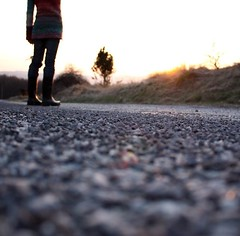 road trip (.nevara) Tags: portrait human autoportrait female faceless light sunset sundown selftimer bokeh hbw dof road place me j jaju people rock sun trees silhouette gumboots rubberboots blurred back foot feet shoes sweater