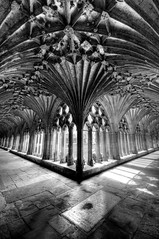 The Cloister at Canterbury Cathedral (II - portrait) (5ERG10) Tags: uk greatbritain light portrait england blackandwhite bw church sergio photoshop garden vanishingpoint kent nikon arch shadows cathedral unitedkingdom interior gothic arcade perspective sigma arches canterbury symmetry bn chiesa ornament monks handheld symmetric vault cloister arcata cells cloisters hdr highdynamicrange chiostro colonnade monastic worldheritage inghilterra enclosed cattedrale archbishop d300 refectory 10mm 3xp photomatix sigma1020 tonemapping amiti 5erg10 sergioamiti