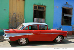 Red on blue and green and yellow and......... (steverichard) Tags: auto street old blue houses homes red house green chevrolet belair car yellow vintage rouge calle vibrant steve cuba unesco chevy american richard trinidad vehicle motor cuban rosso cubano abigfave steverichard carparkedonacubanstreet