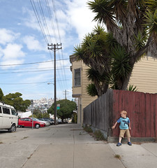 (Alan W George) Tags: sanfrancisco california ca street boy urban cars skyline corner outside person unitedstates telephone pole sidewalk daytime hiding drama staged largeformat pursuit smallchild asaalanwgeorge