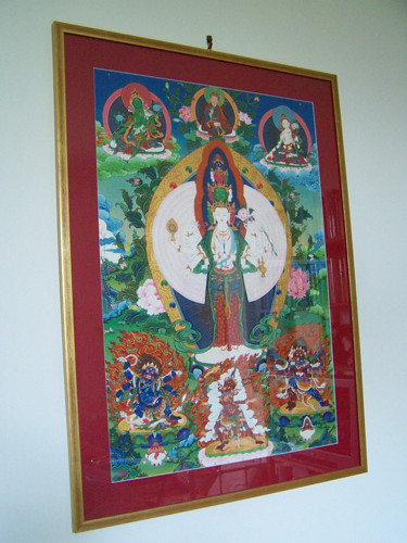 1000-arm Chenrezig by Migmar, framed in gold with a burgundy mat