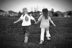 Running Free (* Bluebell) Tags: houses blackandwhite love grass playground kids running powerlines holdinghands vignette neighbourhood bestfriends 4yearold handinhand boyandgirl 3yearold suberbs youngchildren photographerinancasterhamiltonburlingtonontario