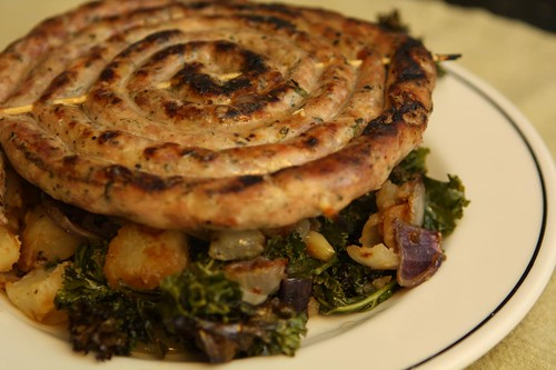 Grilled Rope Sausage with Carmelized Onions, Potatoes, and Kale