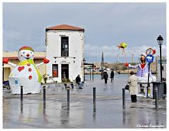 (Eleanna Kounoupa) Tags: street carnival rain reflections snowman greece crete oldport rethymnon     hccity     stphotographia