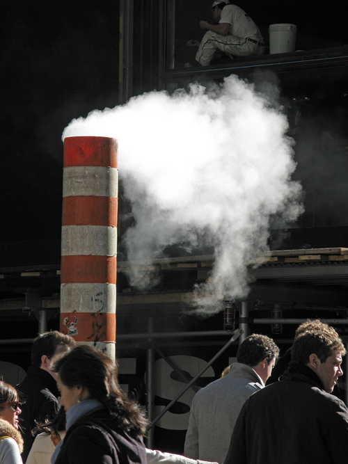 steam puffs as pedestrians pass by, Manhattan, NYC