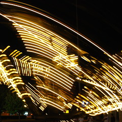 Spinning Lights (StGrundy) Tags: longexposure carnival atlanta summer usa abstract motion black colors yellow night dark georgia lights spider moving lowlight nikon nightshot unitedstates south spin roswell explore southern exposition spinning rides rotating amusements thespider explored d80 focallength34mm exposure08sec aperturef50 peachtreerides theperfectphotographer nikkor1855mmf3556gvr roswellmall