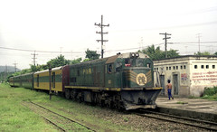 Philippine National Railways (PNR) Diesel locomotive 907 on a down (southbound) passenger train arriving at San Pablo, Laguna, Philippines.