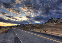 Buttes Sky (Chris Delle) Tags: road sunset clouds canon landscape vanishingpoint 1020 hdr sutterbuttes mountainrange sigma1020mm leadinglines worldssmallestmountainrange 40d