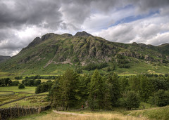 England: Cumbria - The Langdale Pikes (Tim Blessed) Tags: uk trees sky mountains nature clouds landscapes countryside scenery cumbria lakedistrictnationalpark singlerawtonemapped