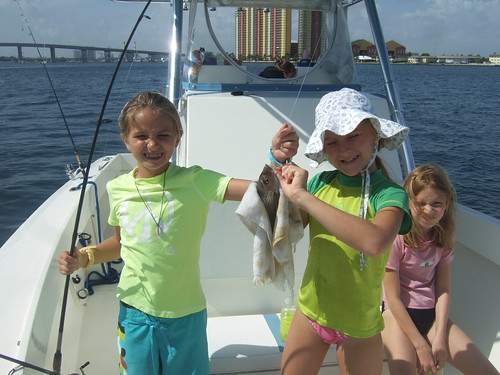 Madeline and Emily help take off fish!