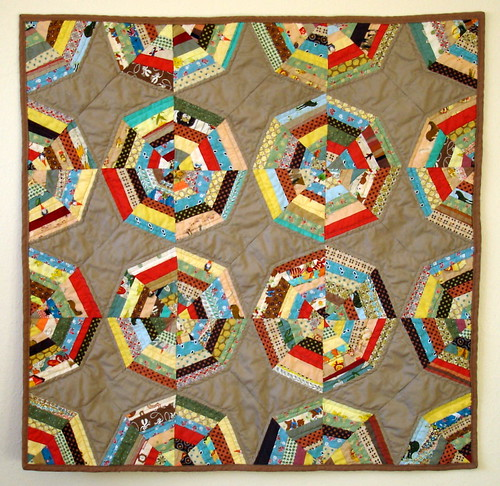 spiderweb quilt in tan
