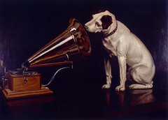"Dog Looking at and Listening to a Phonograph, ""His Master's Voice"", The Original RCA Music Puppy Dog Logo Symbol for Advertising (Beverly & Pack) Tags: pictures music dog pet pets white records art love dogs animal vintage painting puppy advertising logo jack artwork ast russell looking bell antique ad voice graph pit bull player victor pitbull mascot terrier spots listening american record doggy victrola pup recorder windup slogan staffordshire doggie rca edison collectibles hismastersvoice memorabilia bsl nipper phono phonograph sbt oldfashioned puppys amstaff listen hmv publicdomain apbt sylinder breedspecificlegislation doglookingatandlisteningtoaphonograph drhwk7gallery"