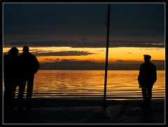 one for you , two for me (maios) Tags: travel sunset sea sky people woman sun man water silhouette greek photo europa europe flickr mediterranean photographer hellas greece macedonia thessaloniki fotografia salonica manikis maios iosif  heliography                iosifmanikis