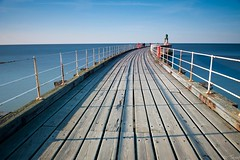pier (colour) (tricky (rick harrison)) Tags: ocean wood blue sunset shadow sea wall pier wooden still fishing long shadows fishermen harbour curves calm deck whitby rails curve beacon railings decking sweep sweeping ruleofthirds leadinglines leadingline